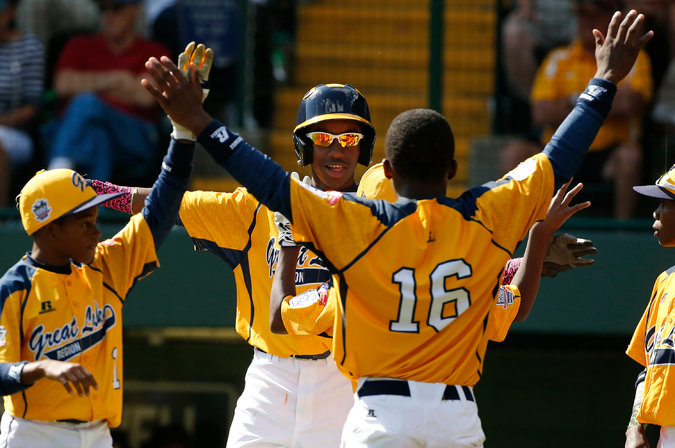 Members of Chicago's Jackie Robinson West Little League team celebrate.