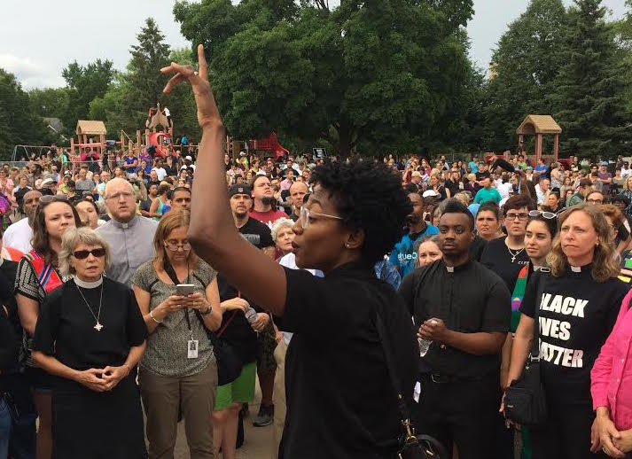 Dee McIntosh, who is in the initial stages of planting Lighthouse Covenant Church in Minneapolis, organized clergy during a vigil Thursday night at the school where Philando Castile worked. She is one of the core leaders of Black Clergy United for Change and Black Lives Matter in the city. Photo by Dan Collison
