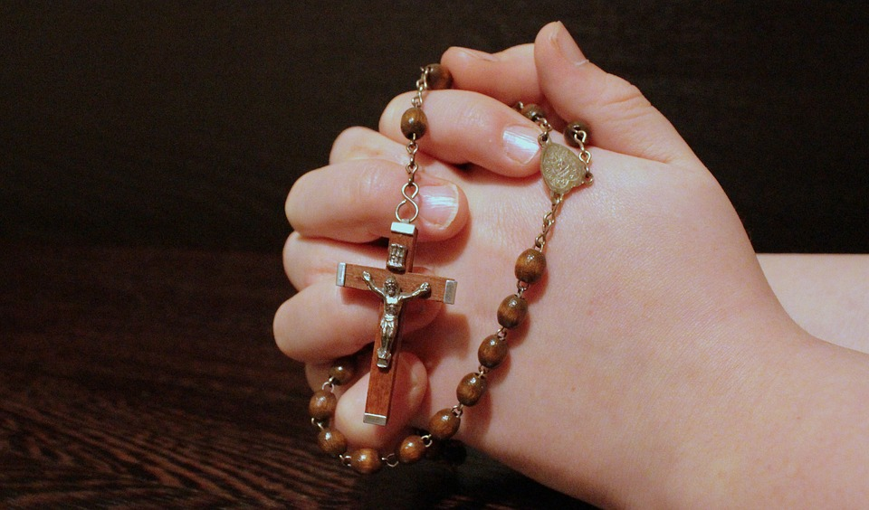 teen rosary hands